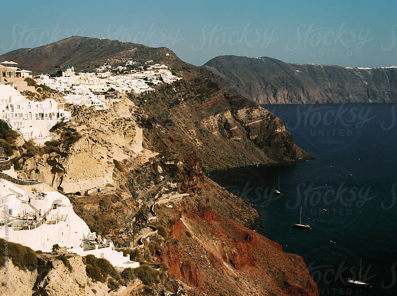 View of village on cliff in Santorini, Greece by Kirstin Mckee for Stocksy United