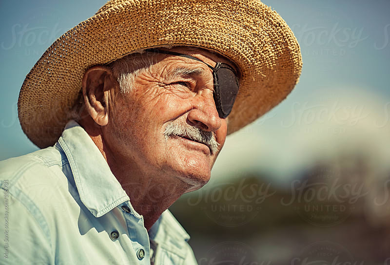 Portrait of an old man with an eye patch.  by Marija Savic for Stocksy United