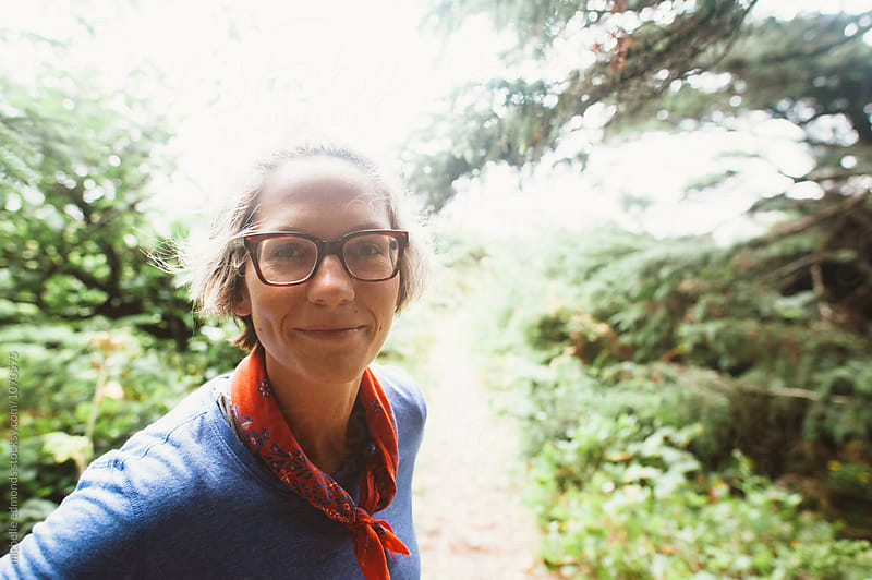 Woman Smiling at Camera on Hiking Trail by michelle edmonds for Stocksy United