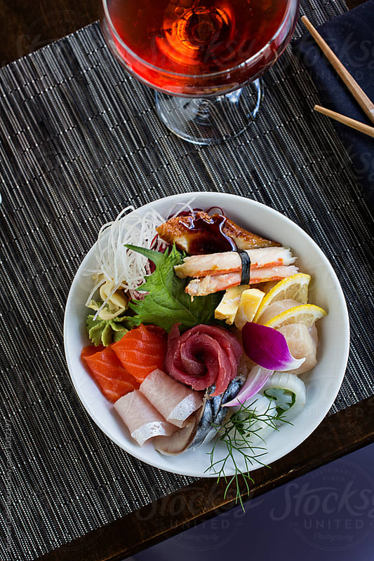 Chirashi sushi bowl of fresh seafood over rice by Andrew Cebulka for Stocksy United