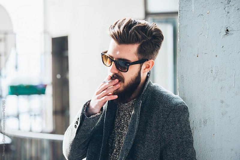 Handsome Bearded Man Smoking Outdoors by Nemanja Glumac for Stocksy United