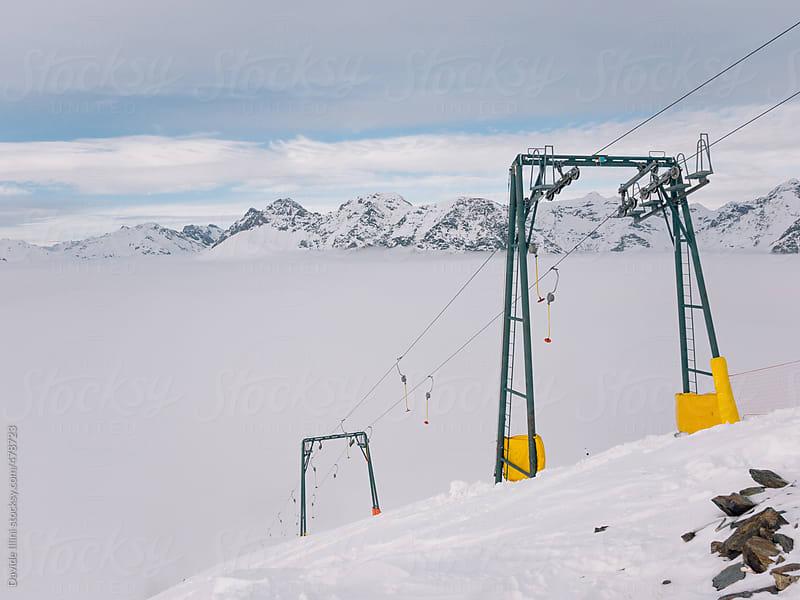 Ski lift in the Alps by Davide Illini for Stocksy United