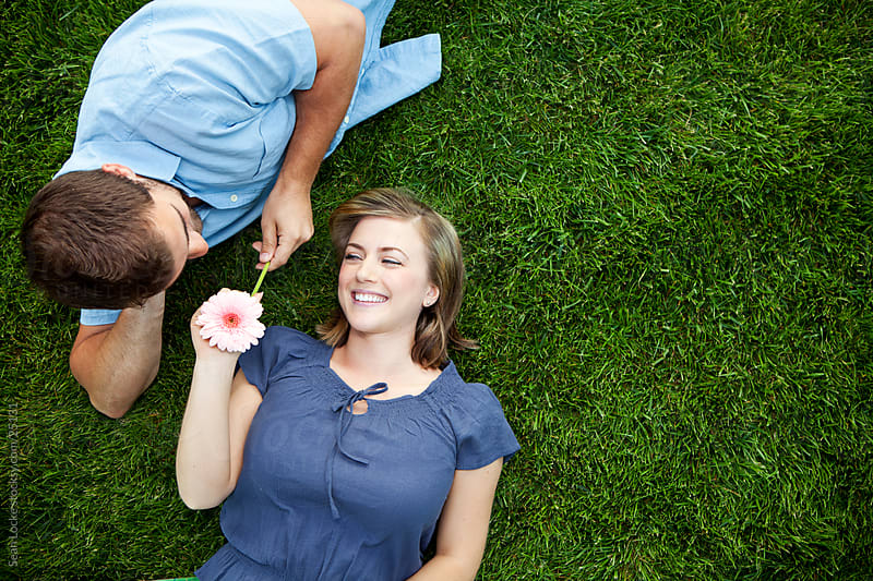 Grass: Couple Sharing a Moment on Grass by Sean Locke for Stocksy United