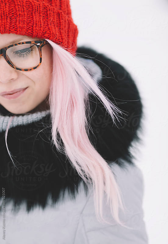 young woman with pink hair and red hat.  by Alexey Kuzma for Stocksy United