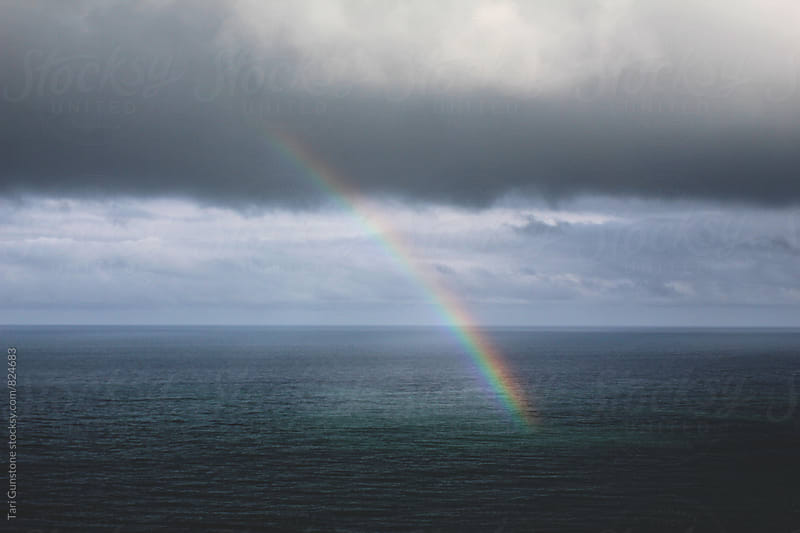 Rainbow on ocean by Tari Gunstone for Stocksy United