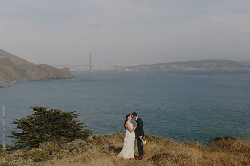 Bride and Groom in front of Golden Gate Bridge by Sidney Morgan for Stocksy United