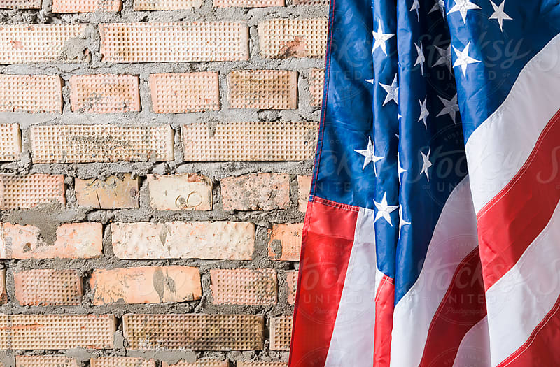 US Flag on the brick wall by Alexey Kuzma for Stocksy United