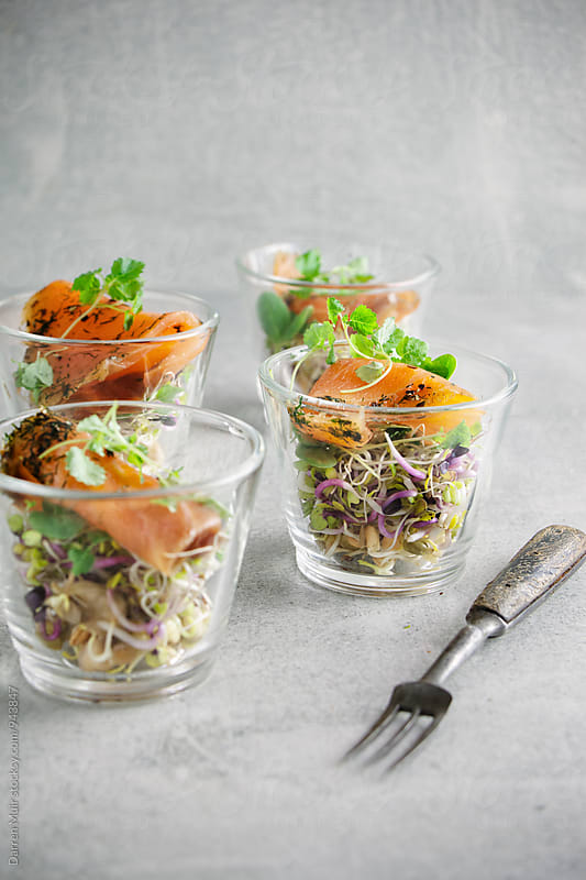 Smoked salmon appetizers with organic sprouts and micro greens. by Darren Muir for Stocksy United