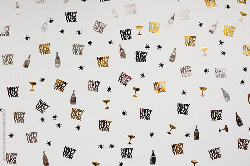 New year confetti on white background by Beatrix Boros for Stocksy United