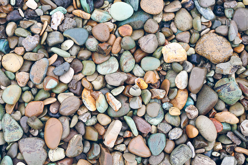 Colorful rocky beach by Denni Van Huis for Stocksy United