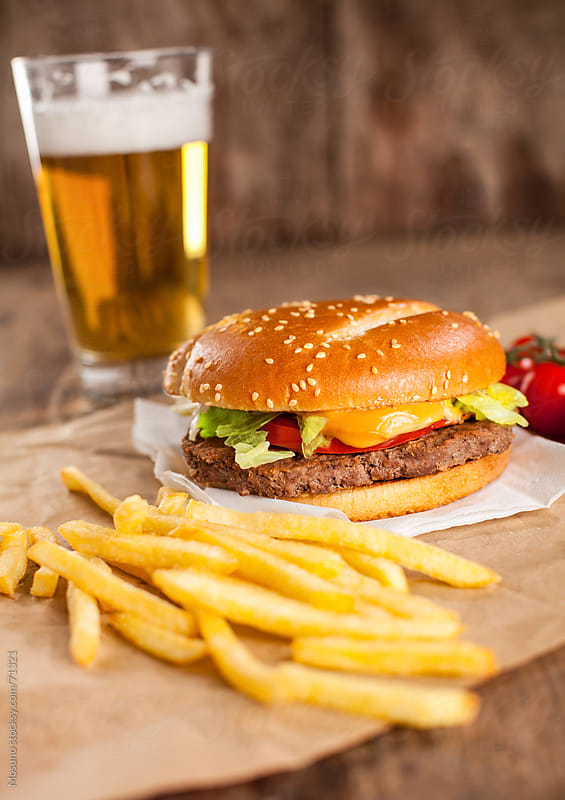 Hamburger and french fries.  by Mosuno for Stocksy United