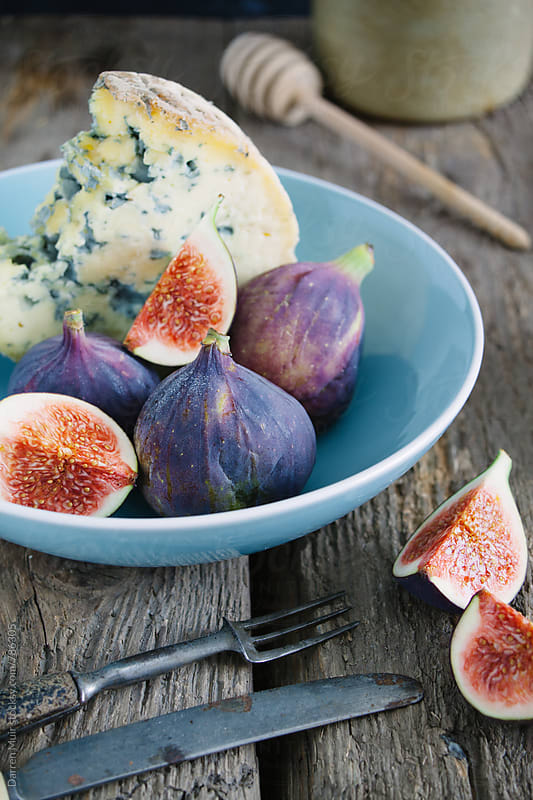 Blue cheese and figs. by Darren Muir for Stocksy United