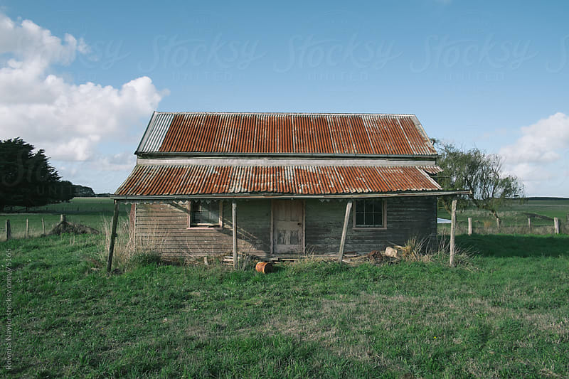 Old Abandoned House on a country road by Rowena Naylor for Stocksy United