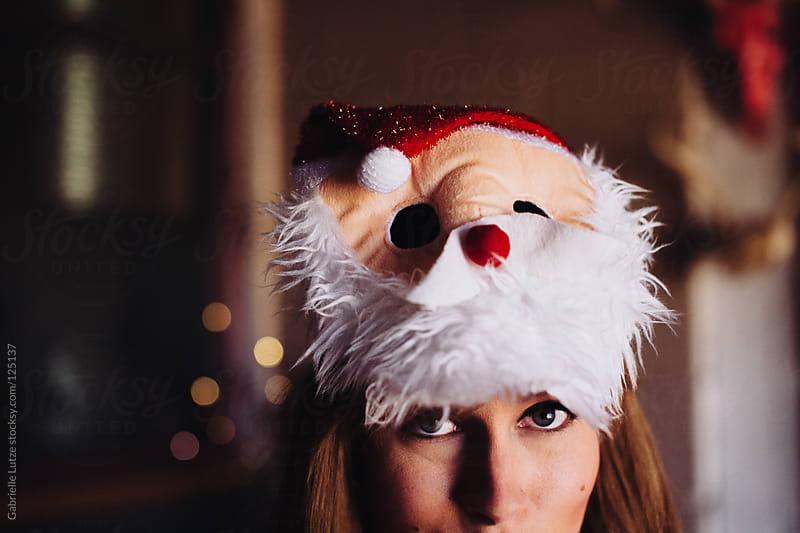 Pretty Girl in Santa Mask by Gabrielle Lutze for Stocksy United