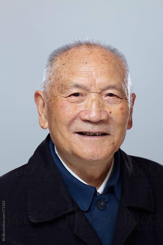 Senior Chinese man portrait by Bo Bo for Stocksy United