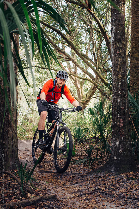 Mountain biker in a forest by Gabriel (Gabi) Bucataru for Stocksy United