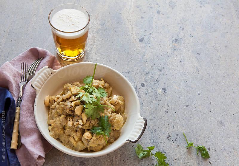 Indian curry dish creamy cashew chicken Murgh Shahi Korma by Nadine Greeff for Stocksy United