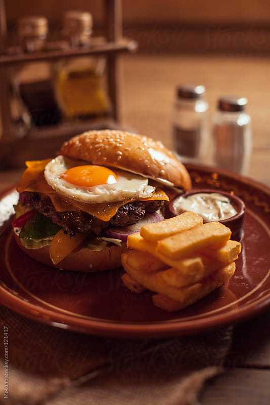 Texas Burger With Egg and French Fries by Mosuno for Stocksy United