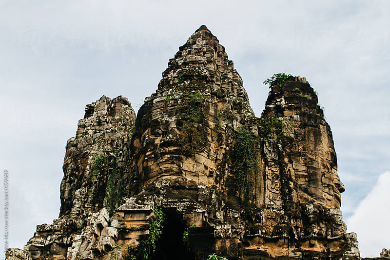 Ancient faces of Angkor Thom temples  by Jesse Morrow for Stocksy United