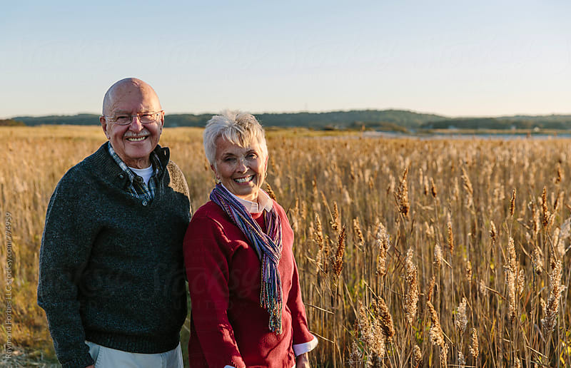 Senior Couple on Autumn Walk by Raymond Forbes LLC for Stocksy United