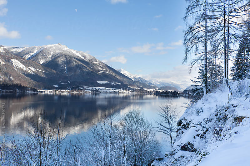 Winter landscape with mountain reflection near Mondsee, Salzburg, austria by Robert Kohlhuber for Stocksy United