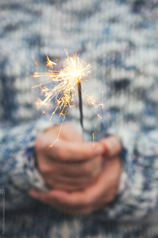Sparkler close-up by Pixel Stories for Stocksy United