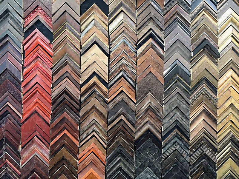 Detail of various wood framing samples on wall by Paul Edmondson for Stocksy United