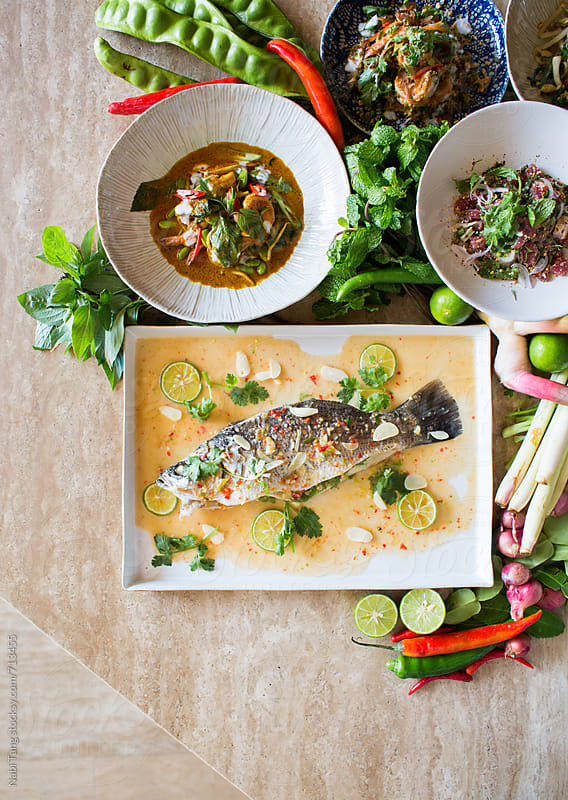 Variety of Thai food on dining table from above by Nabi Tang for Stocksy United