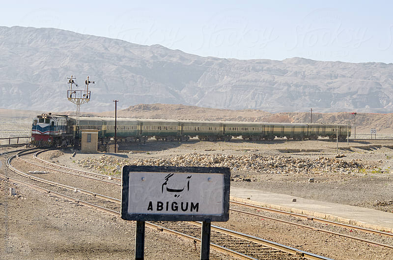 A train approaching a desolate Railroad station. by Agha Waseem Ahmed for Stocksy United
