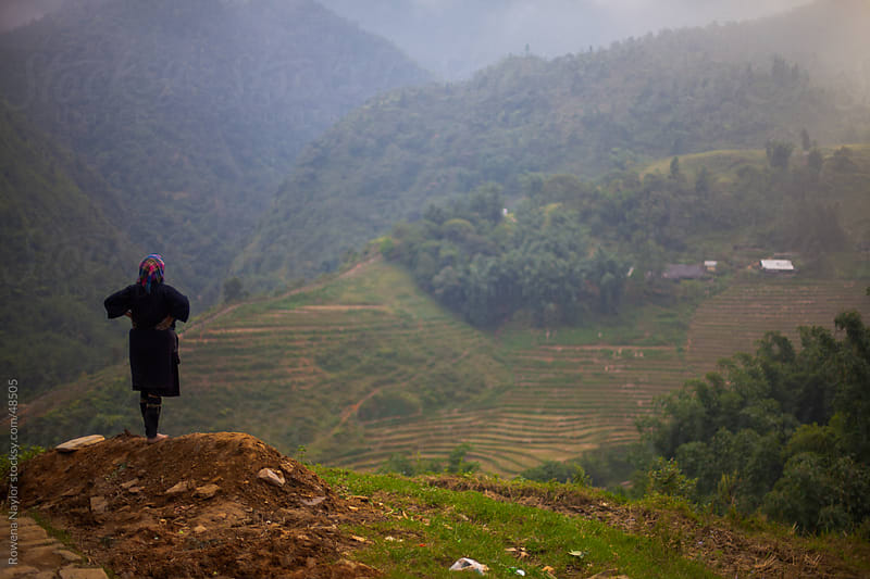 Ethnic Villager overlooking Mountain region in Sapa, Northern Vietnam by Rowena Naylor for Stocksy United
