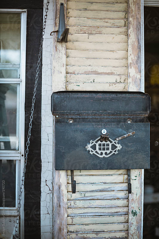 rustic open mail box fixed to weathered wall by Image Supply Co for Stocksy United