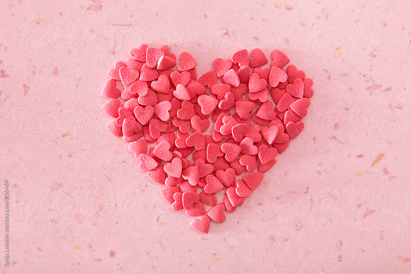 heart made of many hearts on pink background by Sonja Lekovic for Stocksy United