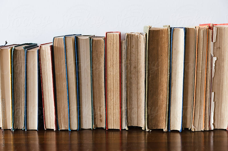 Row of vintage books by Jacqui Miller for Stocksy United