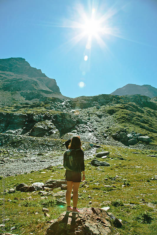 Hiker woman contempling a beautiful landscape. Alps, france. by BONNINSTUDIO for Stocksy United