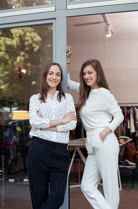 Small business owners in the door way of their Boutique. by W2 Photography for Stocksy United