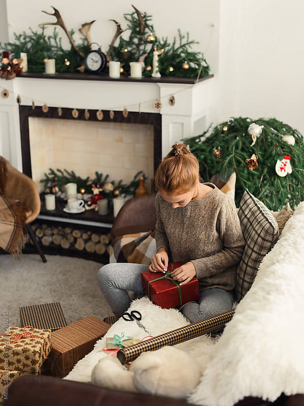 Woman Wrapping Gifts by Milles Studio for Stocksy United