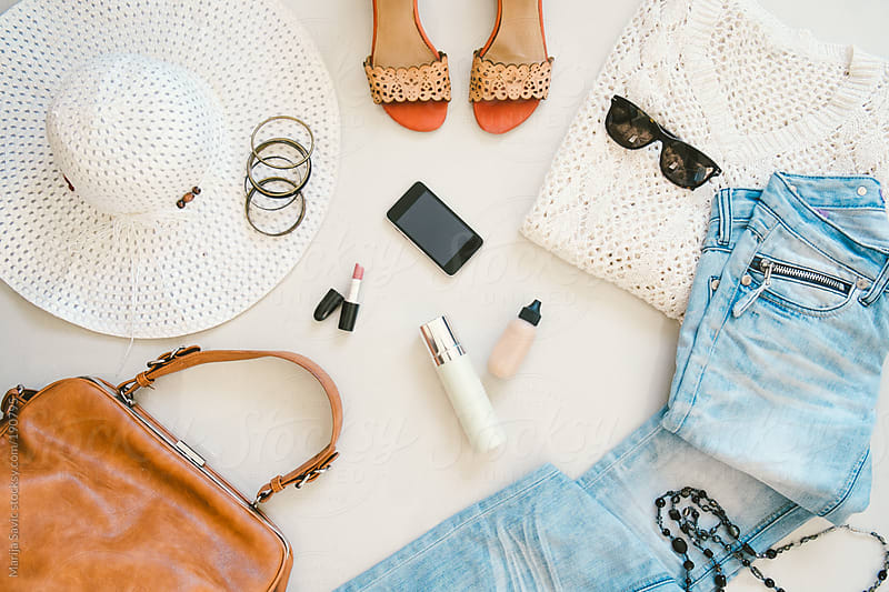Various Clothing Items and Accessories for Women on White Surface by Marija Savic for Stocksy United