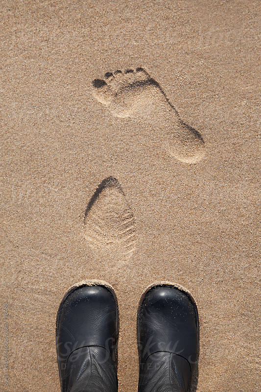 feet and footprints on sand by Sonja Lekovic for Stocksy United