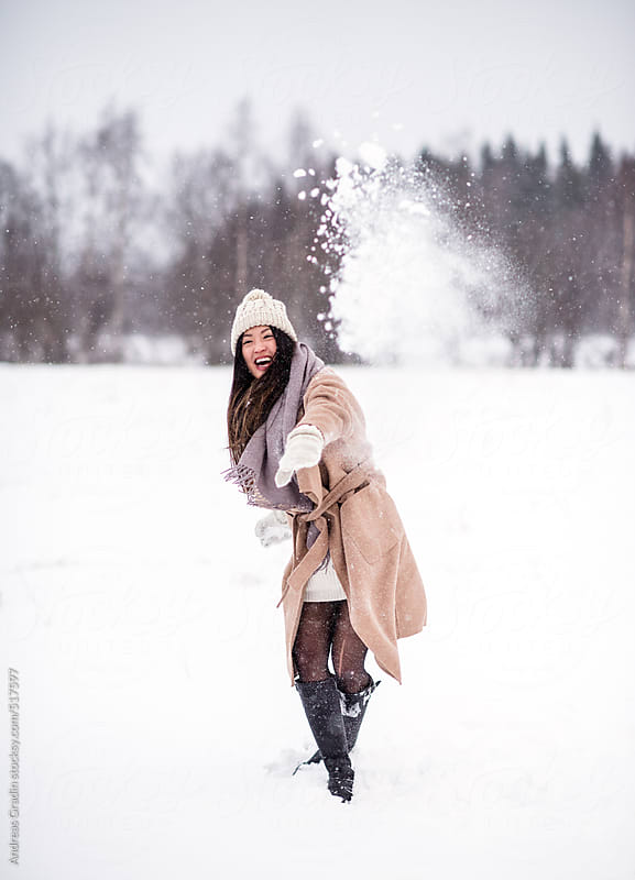 fun in the snow by Andreas Gradin for Stocksy United