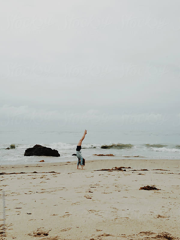 Woman Doing a Handstand on the Beach by Kevin Russ for Stocksy United