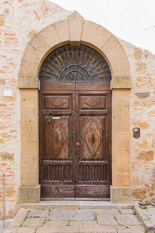 Old tuscan door by Marilar Irastorza for Stocksy United