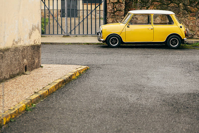 Yellow Classic Car in a Rural Street by VICTOR TORRES for Stocksy United