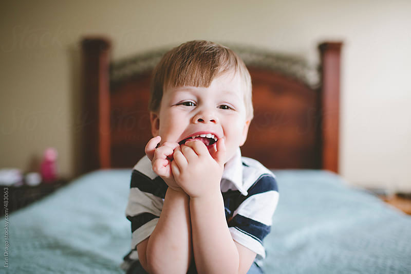 toddler boy making a silly face by Erin Drago for Stocksy United
