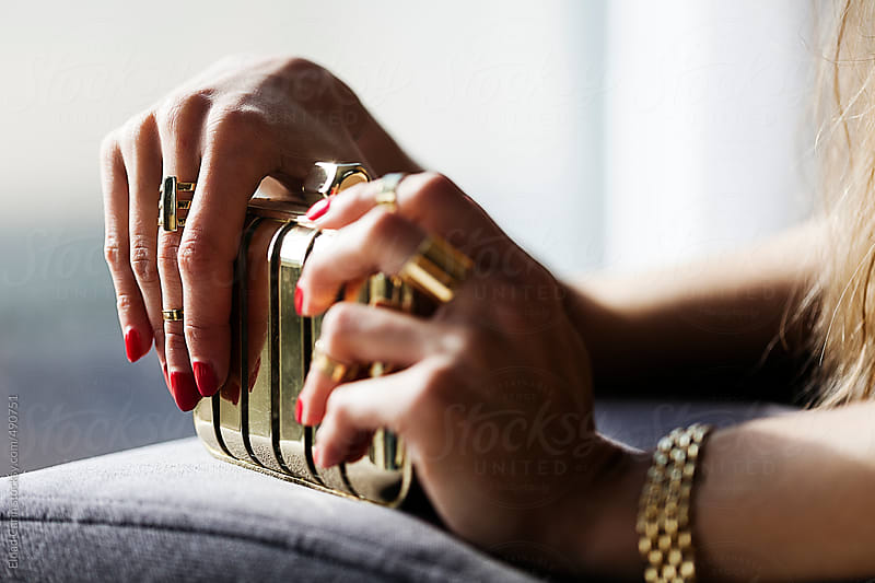 Elegant Woman's Hands on Golden Purse by Eldad Carin for Stocksy United