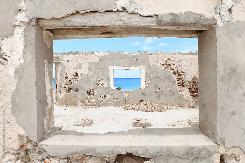 Sea view through an abandoned house  by Gabriel Diaz for Stocksy United