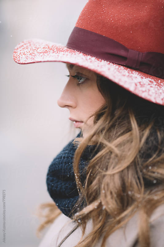 young woman with red hat  by Alexey Kuzma for Stocksy United