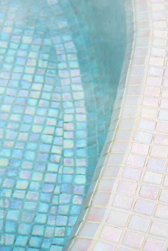 Blue surface on a swimming pool by Bisual Studio for Stocksy United