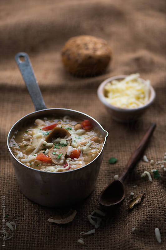 soup with rice and mushrooms by Laura Adani for Stocksy United