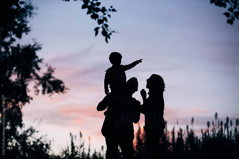 Family at sunset by Blai Baules for Stocksy United