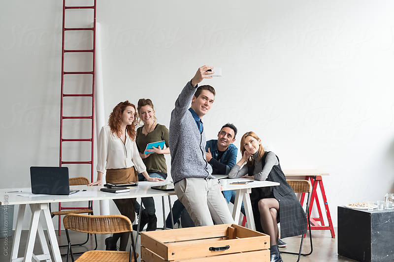 Young teamwork portrait in modern office by Simone Becchetti for Stocksy United